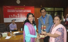 Sabrina Sharmin, Communications Coordinator of RDRS Bangladesh (left) receives the Girl Power Award for RDRS