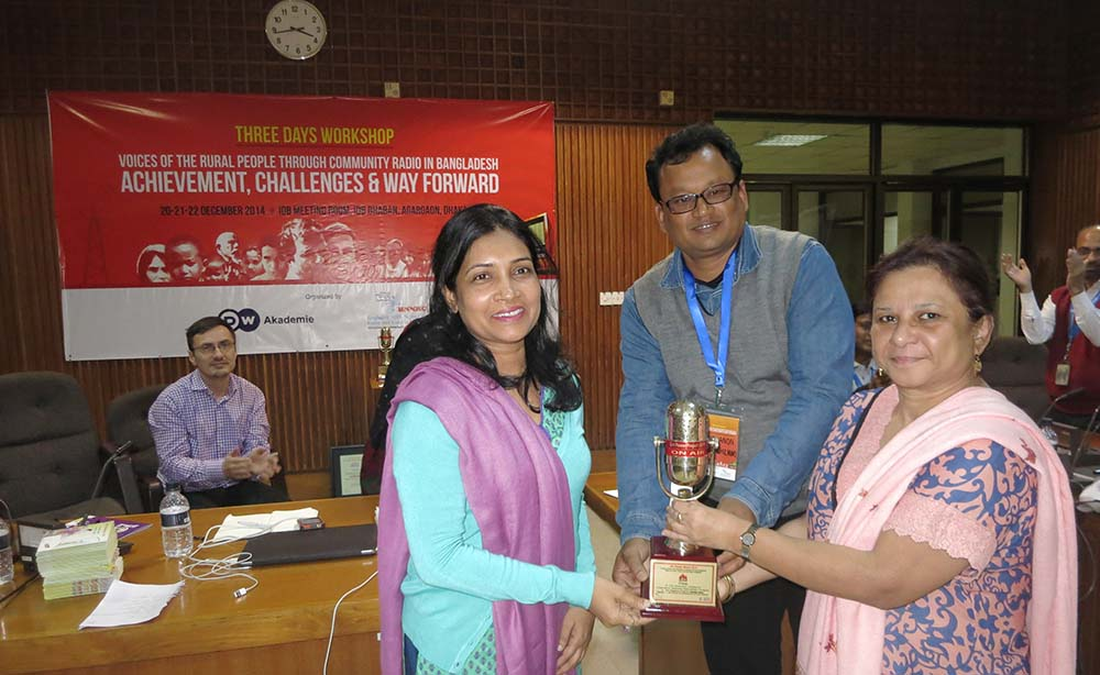 Sabrina Sharmin, Communications Coordinator of RDRS Bangladesh (left) receives the Girl Power Award for RDRS