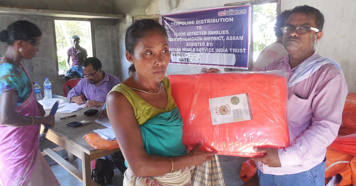 Woman-headed-family-receiving-relief-materials2
